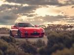 绝美风景下的红色跑车图片壁纸